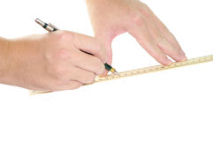 Hands drawing with pencil and ruler Royalty Free Stock Photos