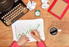 Hands drawing stock chart Stock Photography