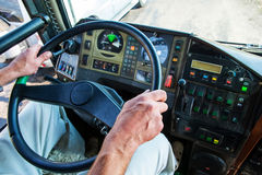 Hands of the driver controlling bus. Hands of the driver of the bus on background of the instrument panel Royalty Free Stock Photos