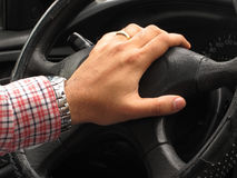 Hands of driver playing the horn Stock Image