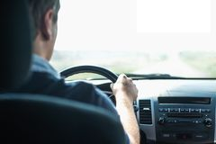 Hands of a driver on wheel. Hands of a driver on steering wheel of a car Stock Photography