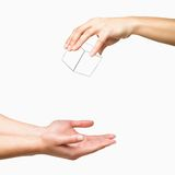Hands dropping white cube on white background Royalty Free Stock Photography