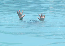 Hands of drowning boy. Needing help and assistance Stock Image