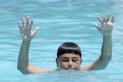 Hands of drowning boy Royalty Free Stock Photo