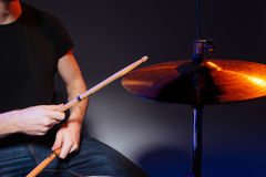 Hands of drummer with sticks playing drums Stock Photography