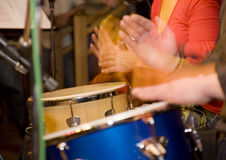 Hands and drums. Expressing bright shot of hands on the drums Stock Photos