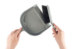 Hands with dustpan and brush floor sweeper Royalty Free Stock Photo