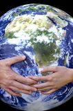 Hands and Earth Royalty Free Stock Image