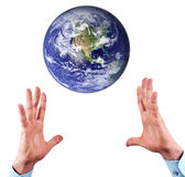 Hands and earth Stock Images