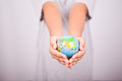 Hands and earth globe. Child hands holding the earth globe Royalty Free Stock Photography