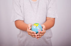 Hands and earth globe. Child hands holding the earth globe Royalty Free Stock Image