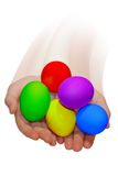 Hands with Easter eggs. Hands holding easter bright colorful eggs Royalty Free Stock Photo