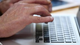 Hands of elderly businessman working with computer in modern office stock video footage