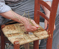 Hands of an elderly craftsman Stock Photos
