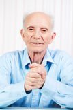 The hands of elderly man are crossed Royalty Free Stock Images