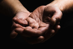 Hands of elderly men show palm on palm Stock Photo