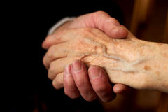 Hands of the elderly. Hands of elderly men and women in a handshake Royalty Free Stock Photography