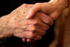Hands of the elderly. Hands of elderly men and women in a handshake Royalty Free Stock Photography