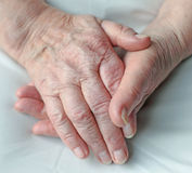 Hands of an elderly person Stock Photos