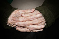 Hands of elderly person Stock Photos