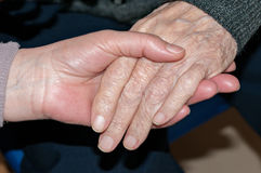 Hands of elderly person Stock Photos