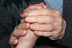 Hands of elderly person Stock Photo