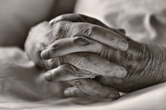 Hands. Of an elderly resting on the bed Royalty Free Stock Photo