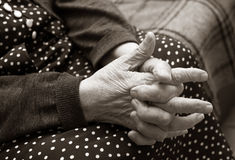 Hands of the elderly woman Stock Images