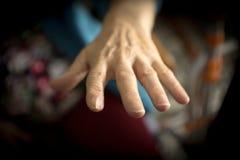 Hands of elderly woman with alzheimer. Doing massage stock photo