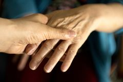 Hands of elderly woman with alzheimer. Doing massage royalty free stock photo