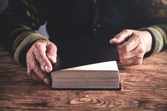Hands of elderly woman with Bible. Religion concept stock image