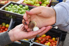 Hands of an elderly woman when buying products on the market Royalty Free Stock Image