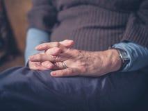 Hands of elderly woman Stock Photos