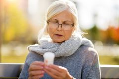 Senior woman checking label on medication royalty free stock photo