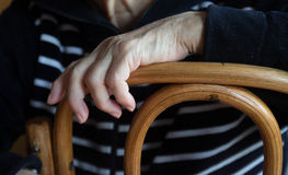 Hands of an elderly woman. Lying on a chair Stock Photo