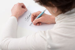 Elderly woman writing testament Stock Photography