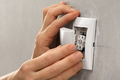 Hands of electrician installing light switch royalty free stock photo