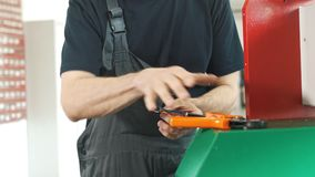 Hands of electrician works with electric wires. Industrial equipment stock video