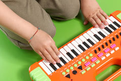 Hands on electronic piano Stock Photography