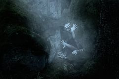 Free Hands Emerge From The Ground, Could It Be Zombies, The Apocalypse Is Coming Stock Photography - 165438532