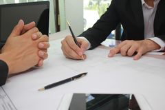 Hands of engineer working on blueprint at office, Business corporate people working concept stock photography