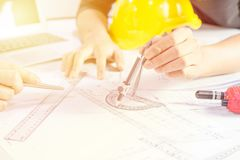 Hands of Engineer working Design on blueprint, Construction concept stock images