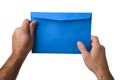 Hands and envelope. Male hands holding a blue envelope Stock Photos