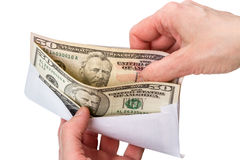 Hands and envelope with dollars Stock Photos