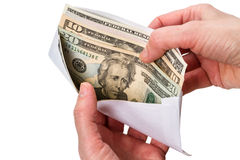 Hands and envelope with Paper Currency Royalty Free Stock Image
