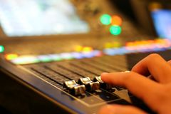 Hands with Equipment for sound mixer control in studio TV stati. On, Audio and Video Production Switcher of Television Broadcast royalty free stock photo