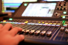Hands with Equipment for sound mixer control in studio TV stati. On, Audio and Video Production Switcher of Television Broadcast royalty free stock images