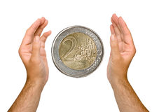 Hands with euro coin Stock Photo