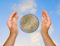 Hands with euro coin Royalty Free Stock Photos