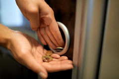 Hands with euro coins at vending machine Stock Photo